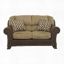 Ashley Vandive Fabric Loveseat in Sand